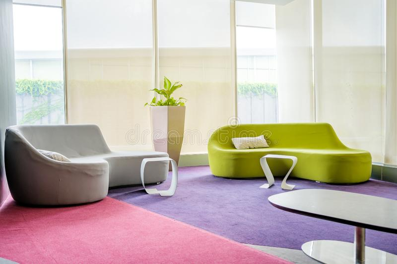 Reception room. Interior of a waiting room, modern office, corridor with two sofa stock image