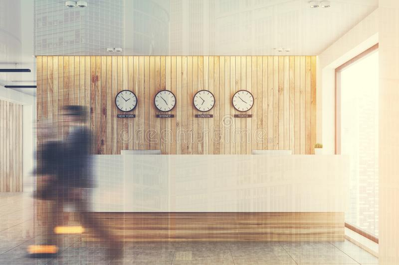 Reception table, world time clocks, wood, toned royalty free stock photos