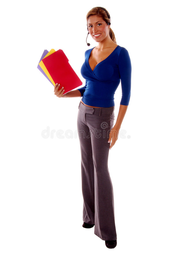 Receptionist. Latin woman working as a corporate receptionist, holding colorful file folders and wearing a wireless headset stock photography