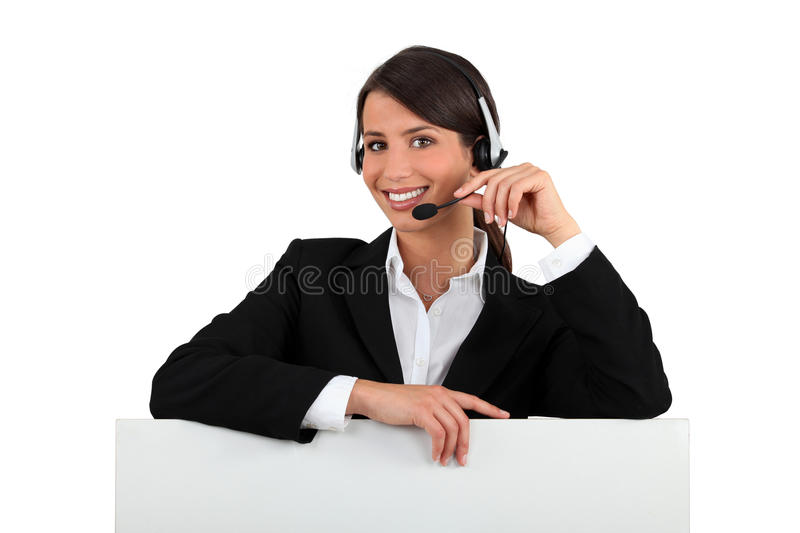 Receptionist. With a telephone headset stock photo
