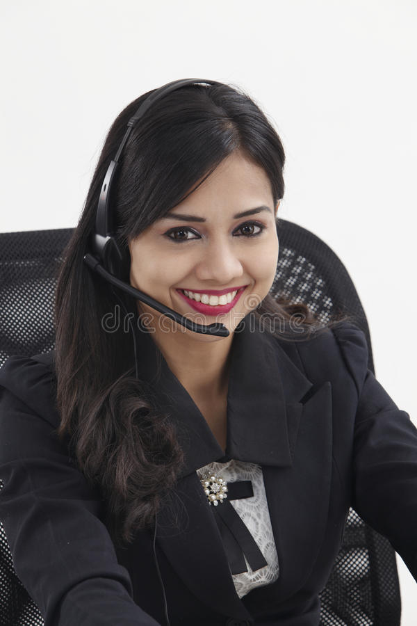 Receptionist. Beautiful receptionist wearing head set talking stock images