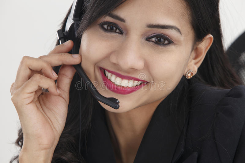 Receptionist. Close up of the receptionist smiling,talking stock photo