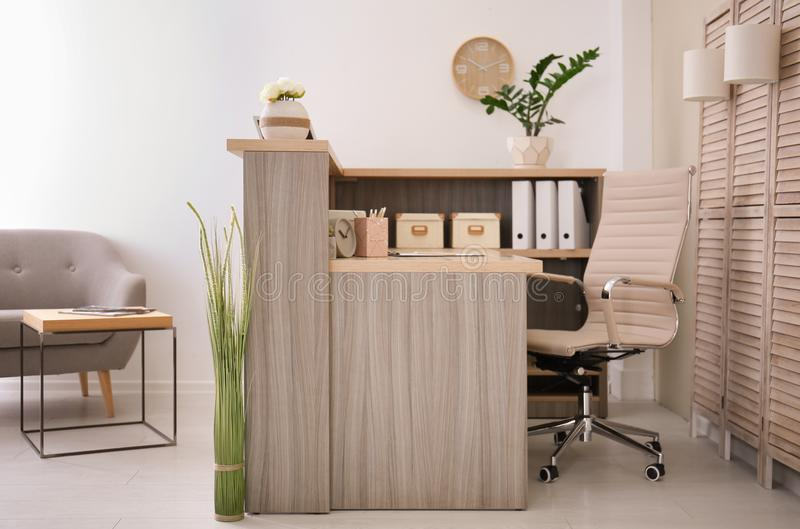 Receptionist desk in hotel. Workplace interior stock photography