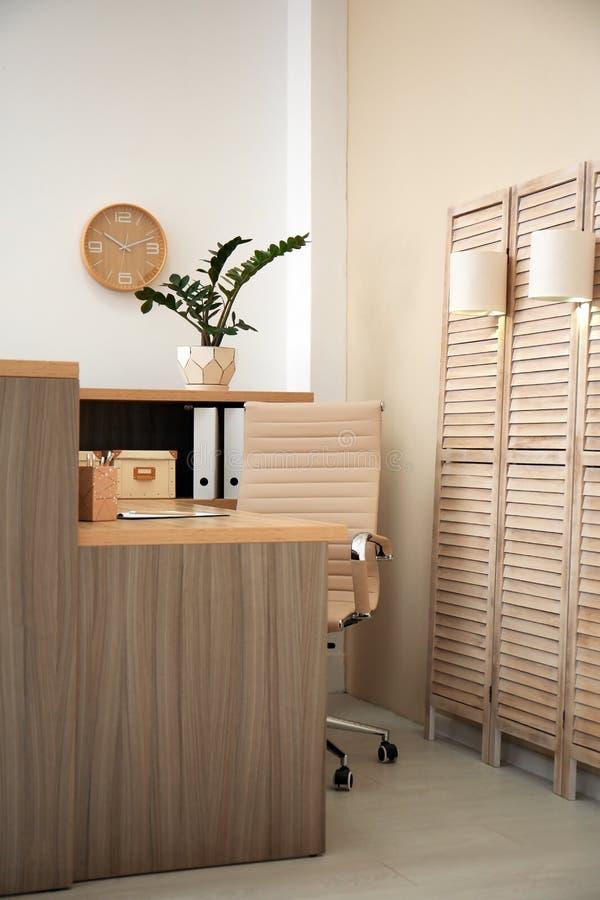 Receptionist desk in hotel. Workplace interior stock photo