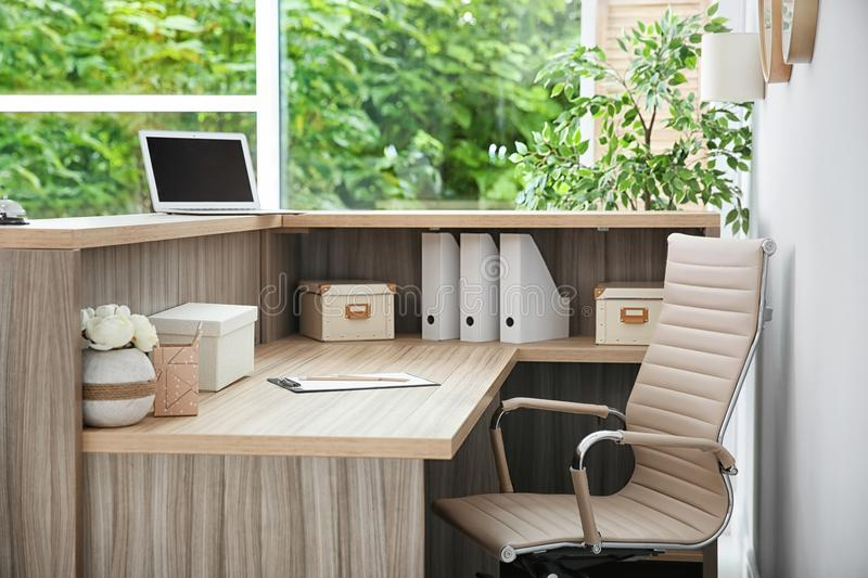 Receptionist desk in hotel. Workplace interior stock images