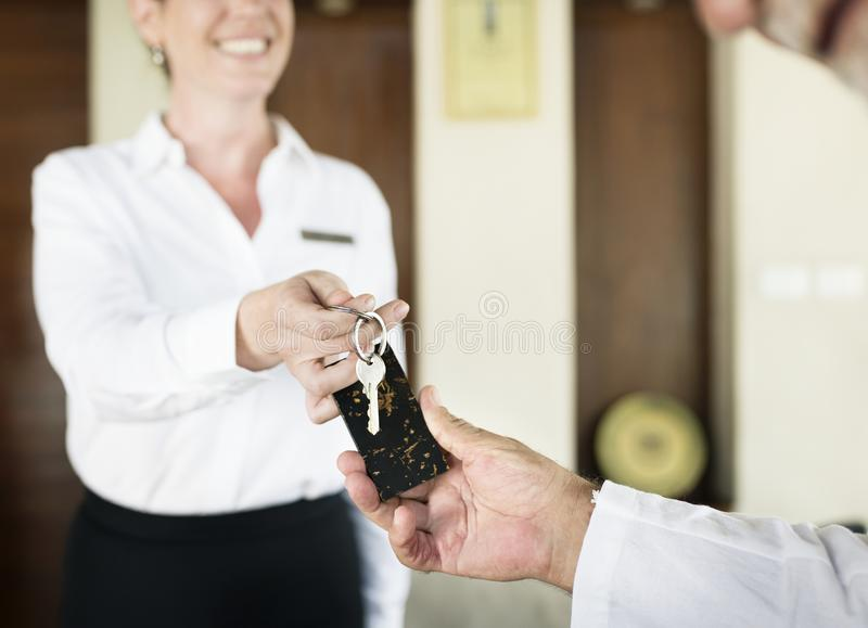 Receptionist handing over the room key stock photos