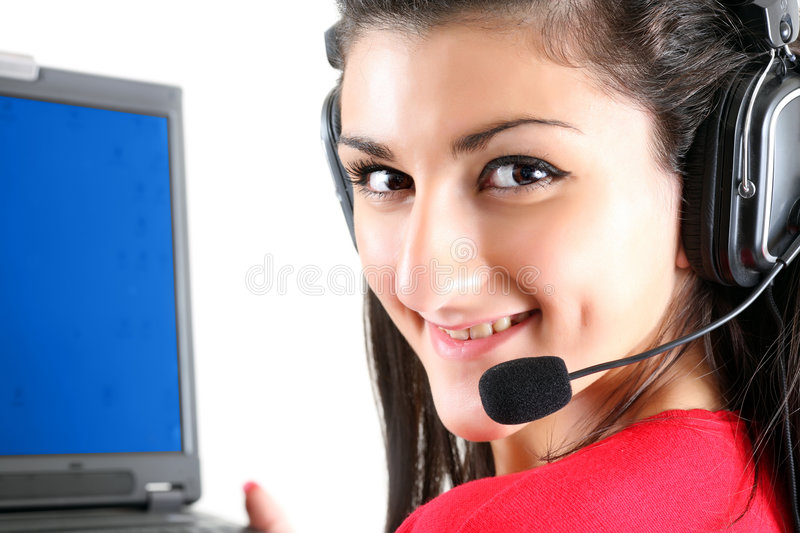 Receptionist with laptop. Portrait of the smiling receptionist in headset before a laptop royalty free stock photography