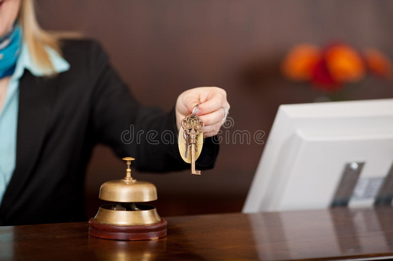 Receptionist passing room keys. Over the counter stock photography