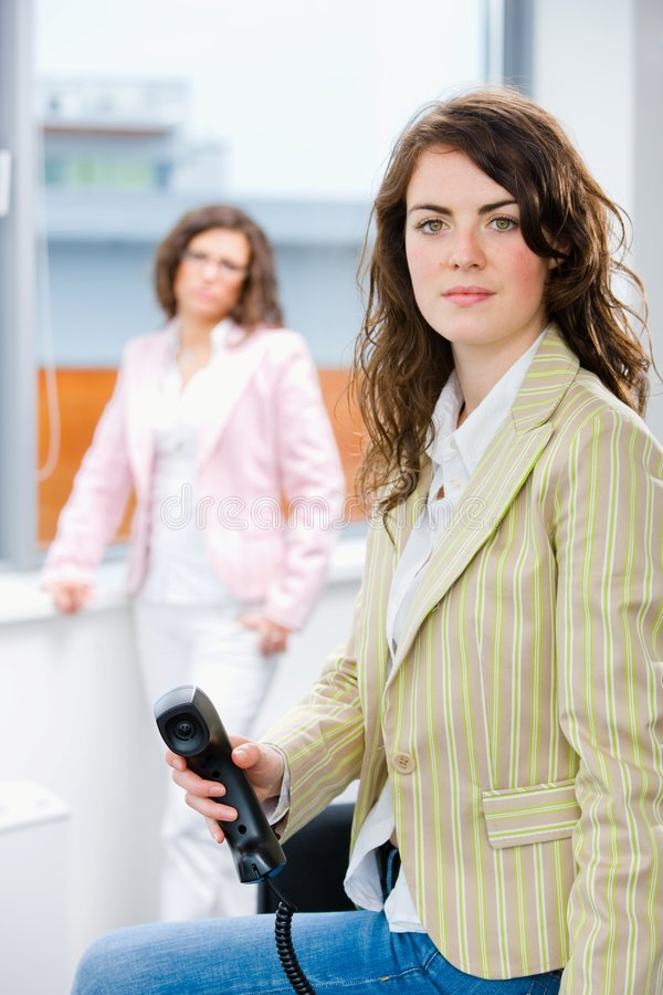 Receptionist Receiving Phone Calls Royalty Free Stock Photography