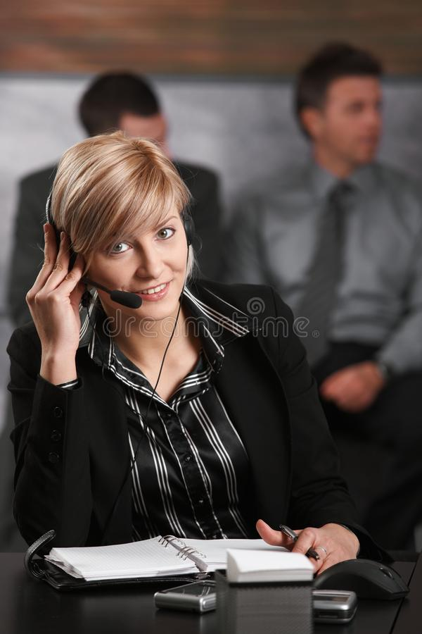 Receptionist talking on phone royalty free stock photo