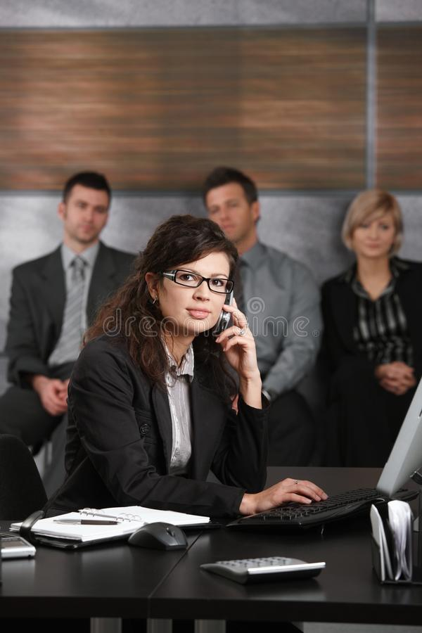 Receptionist talking on phone royalty free stock images