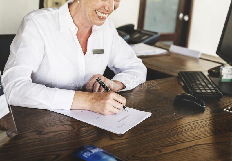 Receptionist working at the front desk royalty free stock photo