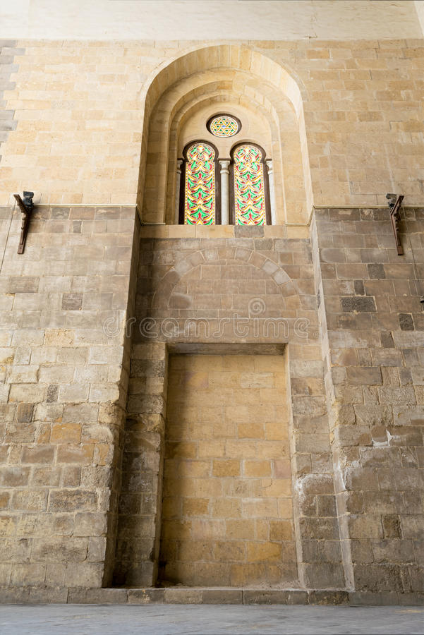Recessed arched frames and two colored stained glass windows royalty free stock photo