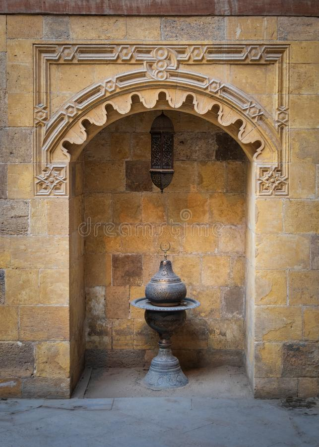 Recessed frame, niche with antique lantern in an old stone bricks wall, Medieval Cairo, Egypt stock photos