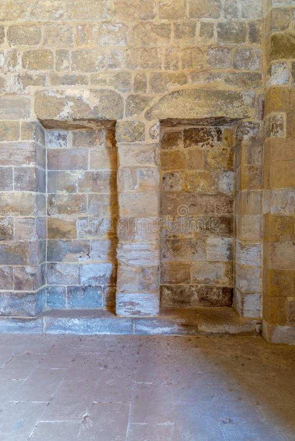 Recessed frame Niche in an old stone bricks wall stock photos