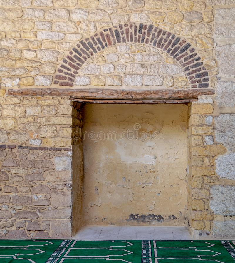Recessed frame in an old stone bricks wall royalty free stock photos