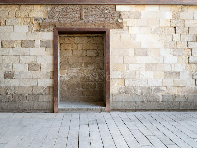 Recessed frame in old stone wall royalty free stock photo