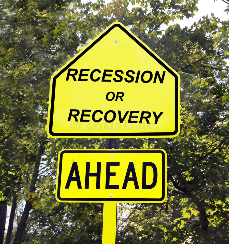 Recession or recovery sign. Yellow sign of recession or recovery ahead with trees in the background stock images