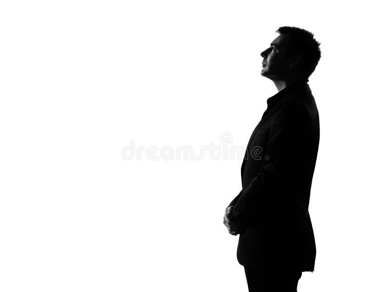Recherche sérieuse de profil d'homme de silhouette image libre de droits