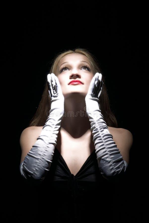 Recherchez et les gants blancs photo stock