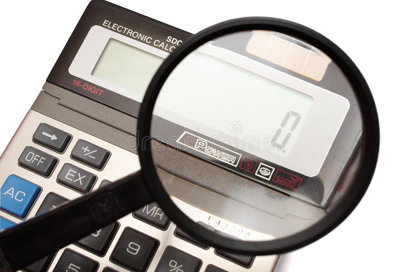 Rechner mit Vergrößerungsglas stockbild