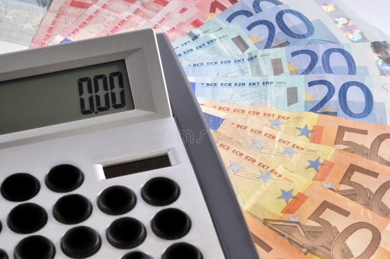 Rechner und Geld stockfotografie
