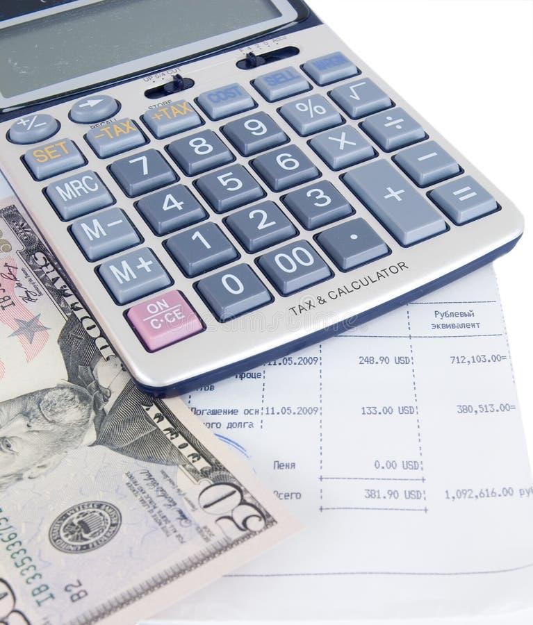 Rechner und Geld lizenzfreies stockfoto