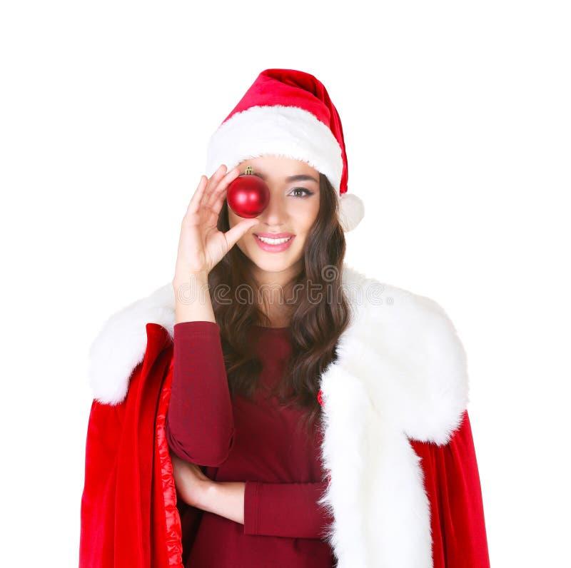 Recht junge Dame in Santa Claus-Kostüm, das glänzenden Flitter hält stockfotografie