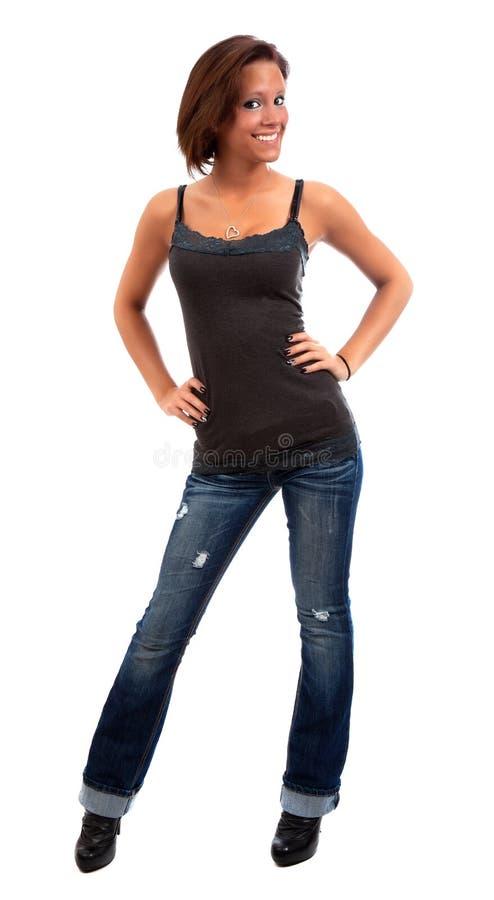 Recht junge Frau, die über Weiß aufwirft. lizenzfreies stockfoto