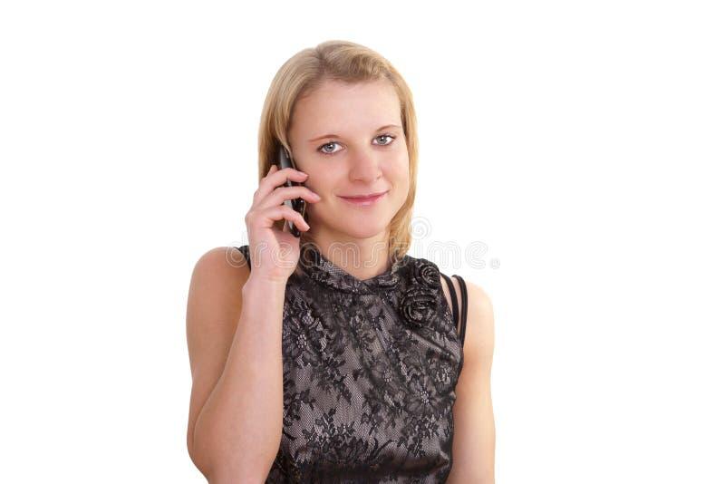 Recht junge Frau mit einem Mobil-Telefon stockfotos