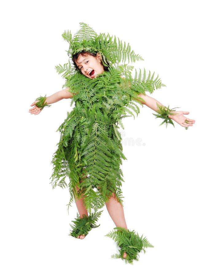 Recht kleines Mädchen gekleidet im Grün stockbild