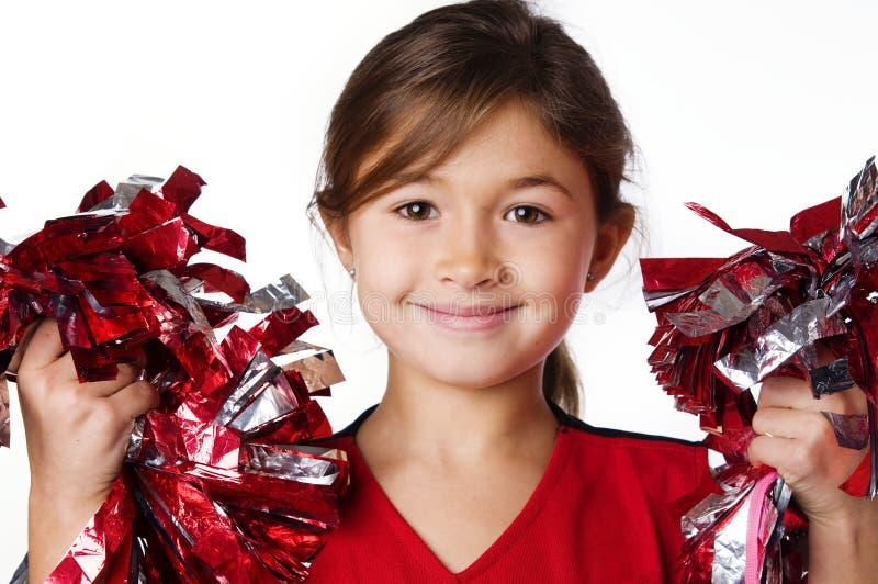 Recht lächelnde Cheerleader des kleinen Mädchens lizenzfreie stockbilder