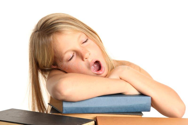 Recht müdes Kind und Bücher lizenzfreies stockbild