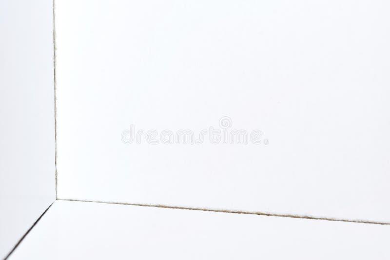 Rechter Winkel eines weißen Kartons Optische Illusion Abstraktion, Geometrie und Optik lizenzfreie stockbilder