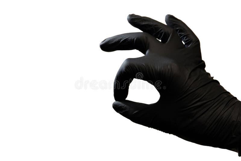 Rechts in een zwarte handschoen op een witte achtergrond is samengesteld als symbool van o.k. De ruimte van het exemplaar royalty-vrije stock afbeeldingen