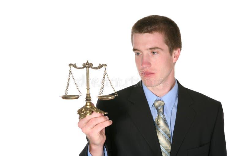 Rechtsanwalt mit Skala stockfotografie
