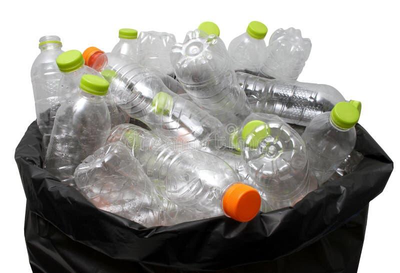 Reciclaje plástico de la botella fotos de archivo