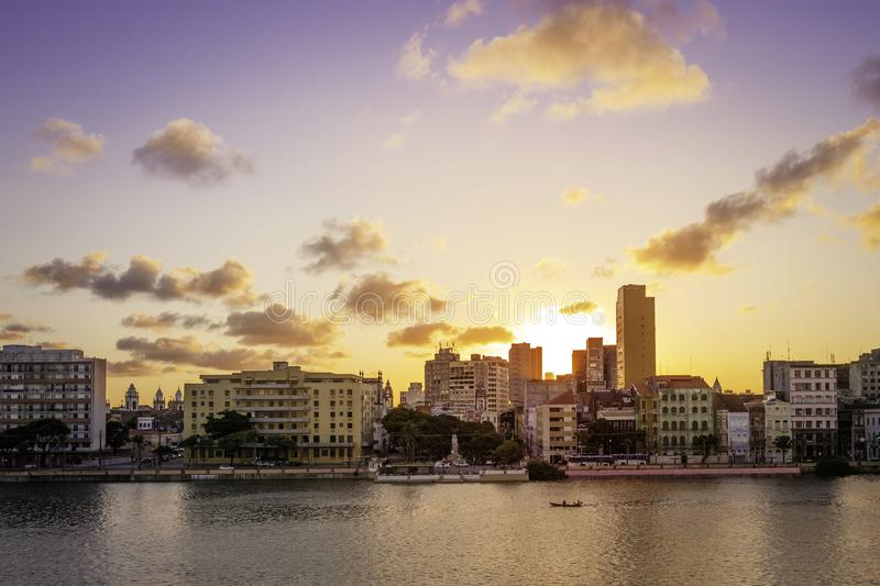 Recife in PE, Brazil. The architecture of Recife in PE, Brazil with its 17th century buildings mixed with contemporary ones at sunset by the Capibaribe River stock image