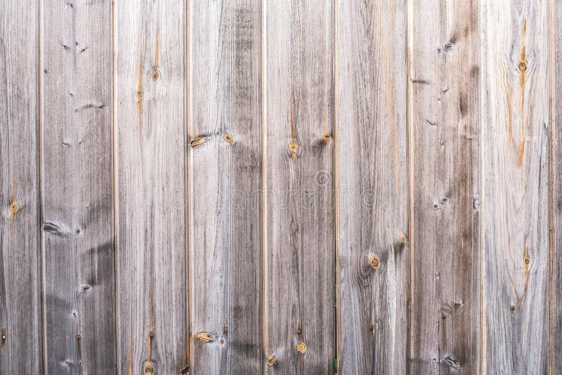 recinto di legno con il fondo grigio di legno della corteccia della plancia rustica, fondo astratto fotografie stock