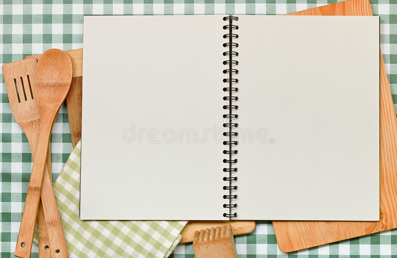 Recipe Backdrop Green Gingham. Double page spread blank ring binder with copy space. Great recipes backdrop on a green gingham table top with kitchen equipment royalty free stock images