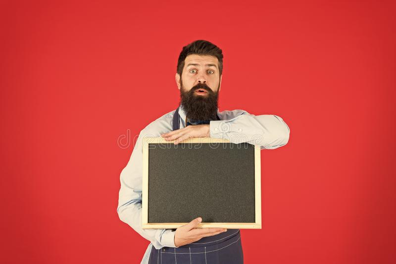 Recipe. great cuisine. cooking by recipe. menu board. bearded hipster cook in apron. welcome. Restaurant or cafe. Advertising. surprised man chef with blank royalty free stock photos