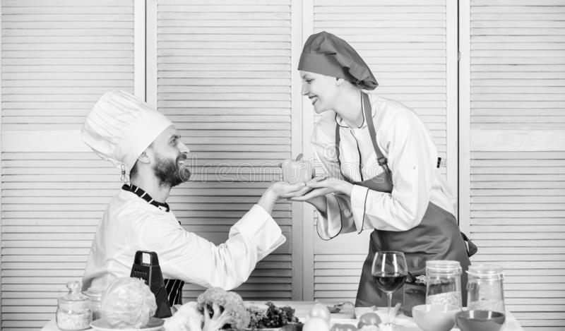 Recipe requires a lot of loving. Dieting and vitamin. culinary cuisine. man and woman chef in restaurant. Family cooking stock image