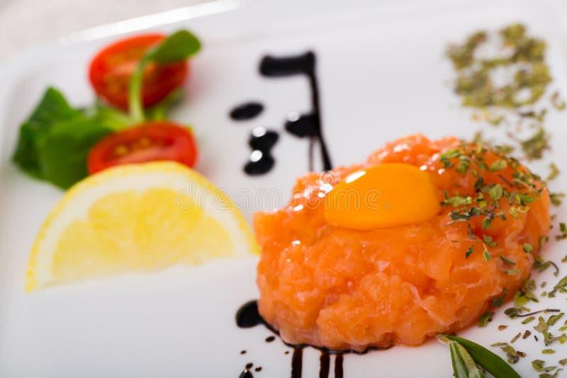 Recipe of tartare of fresh salmon stock photography