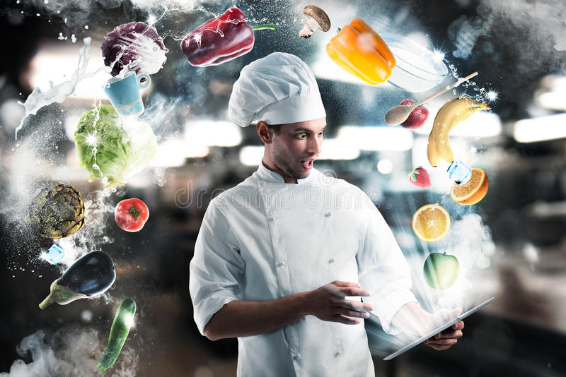 Recipes on the tablet. Chef looks stunned the tablet with fruits and vegetables royalty free stock image