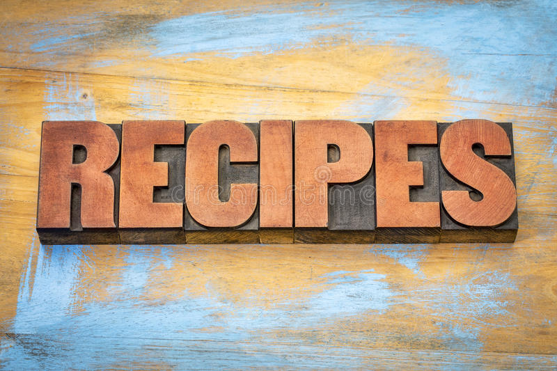 Recipes word in letterpress wood type. Recipes banner - word in vintage letterpress wood type blocks stained by red ink royalty free stock images
