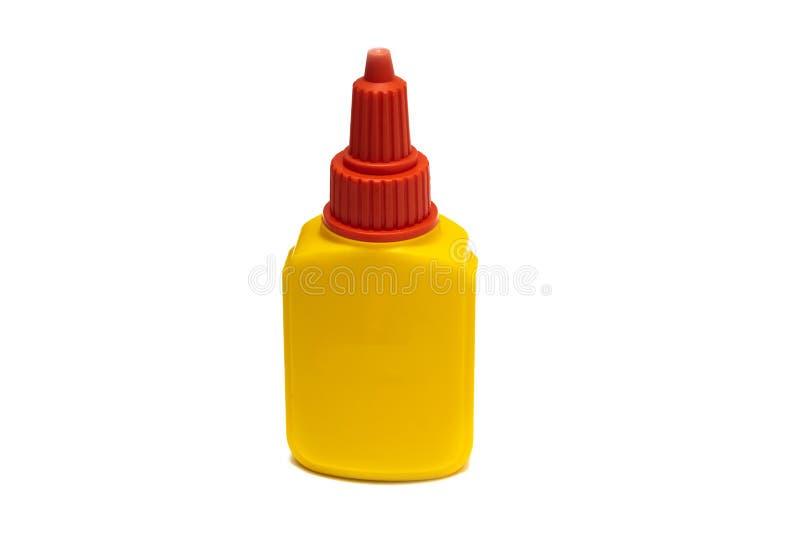 Recipiente amarelo com colagem, isolado em um fundo branco fotos de stock royalty free