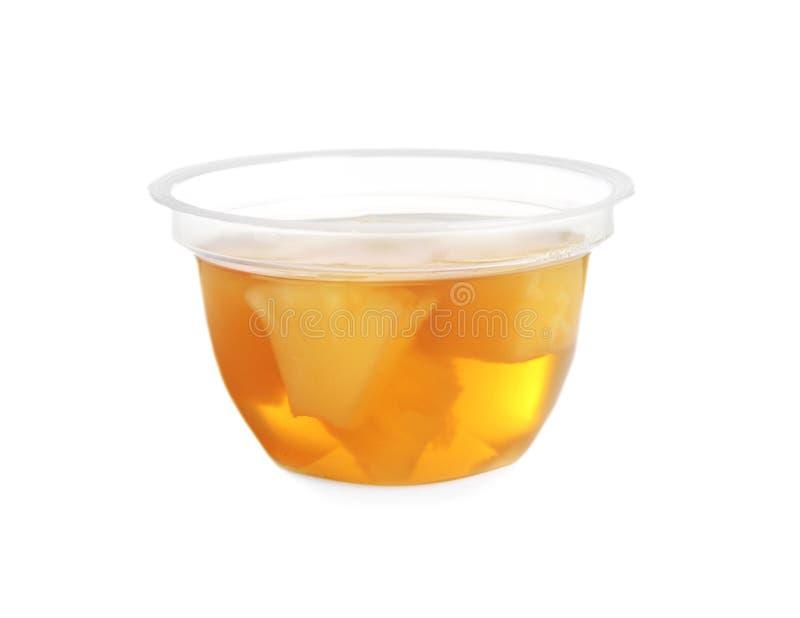 Recipiente pl?stico com geleia saboroso do abacaxi foto de stock