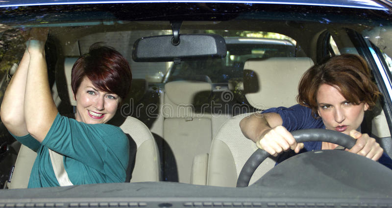 Reckless Driving. Reckless driver and scared female passenger inside a car royalty free stock images