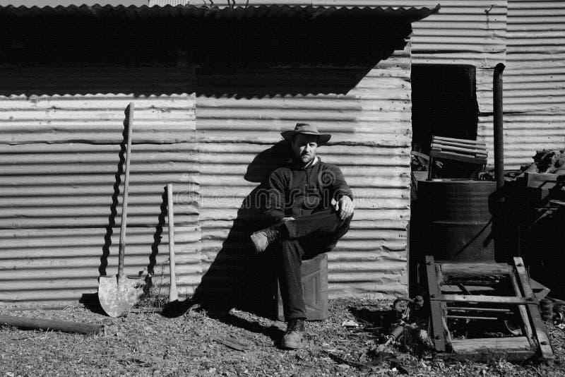 Reclinación del prospector del oro foto de archivo libre de regalías