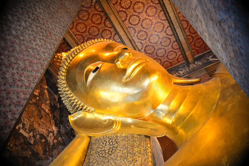 Reclining buddha. Close up face of the reclining buddha in Thailand royalty free stock image